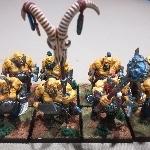 Ver artículos de Games Workshop - Regimiento de 8 Ogros Toro pintados (segunda mano)